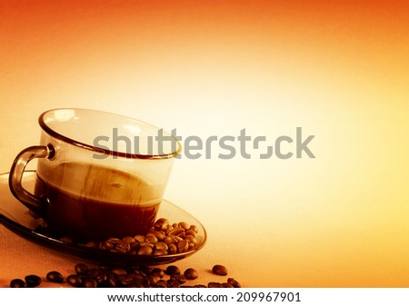 Cup with coffee, costing on coffee grain. - stock photo