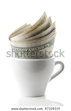 cup with dollars isolated on a white background - stock photo