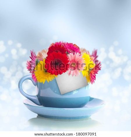 Cup with flowers - stock photo