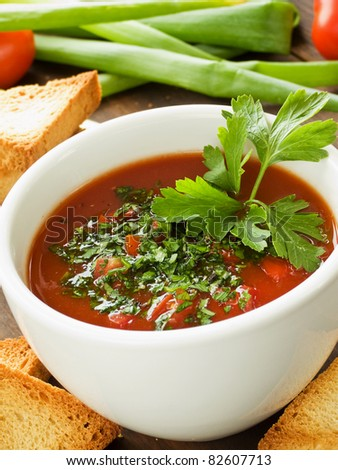 Cup with fresh gazpacho, herbs and croutons. Shallow dof. - stock photo