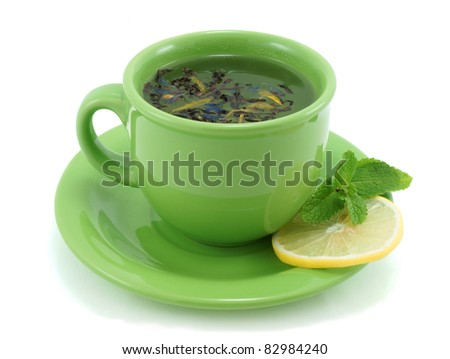 Cup with green tea, with mint and lemon. - stock photo