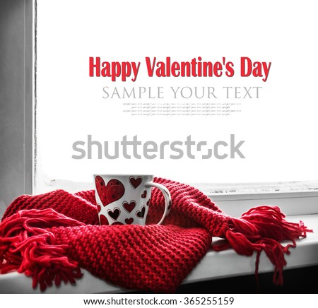 cup with hearts on the windowsill isolated on white background. To use the greeting for Valentine's Day - stock photo