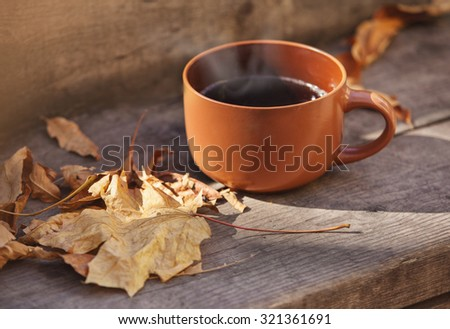 cup with hot drink on a wooden background autumn - stock photo