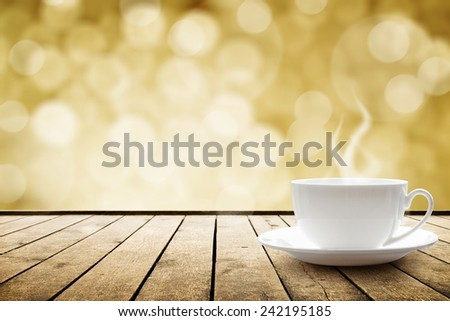 Cup with hot drink on wood table over abstract bokeh  background - stock photo