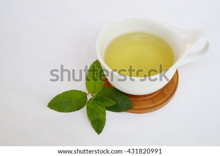 Cup with mint tea and mint leafs