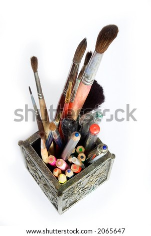 Cup with pens, pencils and brushes - stock photo