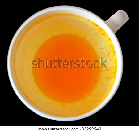 Cup with rest of juice - stock photo