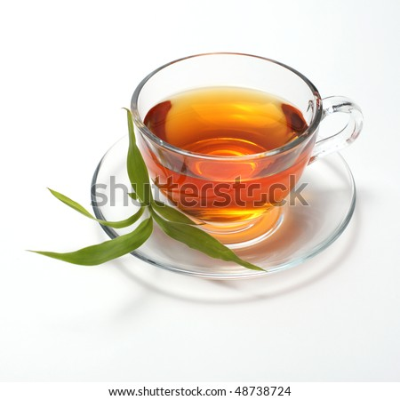 cup with tea and green leaf - stock photo