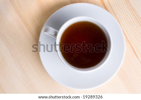 Cup with tea on  wooden table. - stock photo