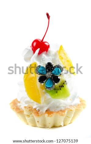 cupcake and bijouterie on a white background