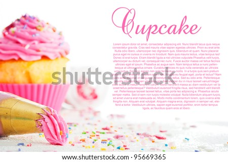 Cupcake and decorating bag on a white table with colorful sugar perls on white background - stock photo