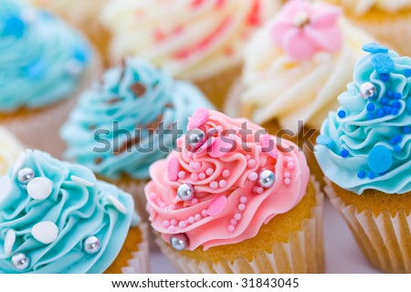 Cupcake assortment, shallow depth of field - stock photo