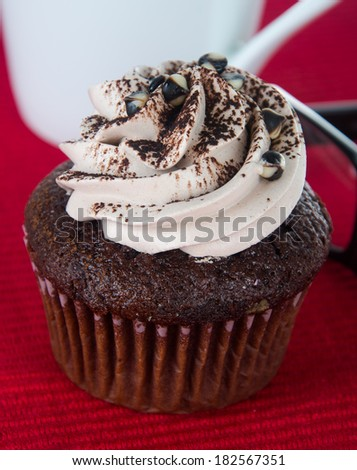 cupcake. chocolate cupcakes on the background. - stock photo
