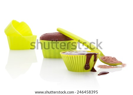 Cupcake chocolate mixture in neon green colored baking forms isolated on white background. Culinary cupcakes baking. - stock photo
