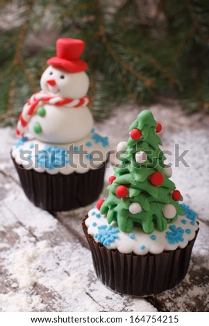 Cupcake Christmas tree on background with snowman - stock photo