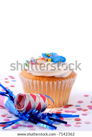 Cupcake, Confetti And Blowout Ready For A New Years Celebration Party, Copy Space For Your Message