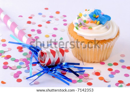 Cupcake Decorated With Colorful Sprinkles, Blowouts And Confetti For A Celebration Party
