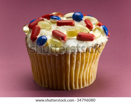 Cupcake decorated with pills, close-up