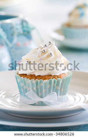 Cupcake for a baby shower - stock photo