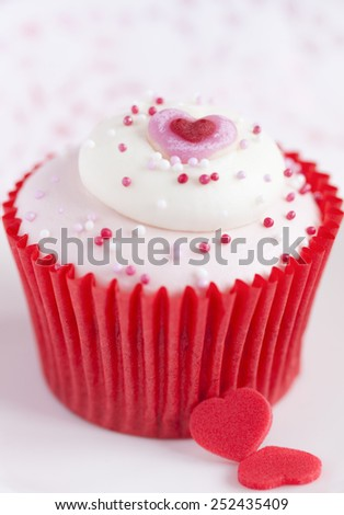 cupcake for Valentine Day on bright background - stock photo