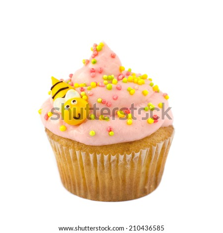 Cupcake frosted with pink cream and sugar decoration isolated  - stock photo