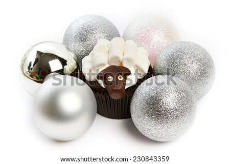 Cupcake lamb with silver Christmas balls as simbol 2015 new years isolated on white background - stock photo