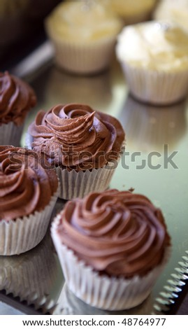 cupcake on a tray. small dessert muffin cakes with frosting on top - stock photo