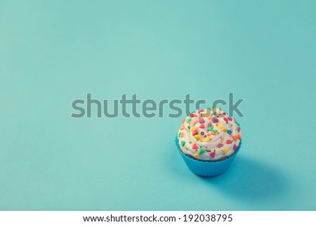 Cupcake on color background. - stock photo