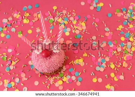 Cupcake on confetti background - happy birthday card - stock photo