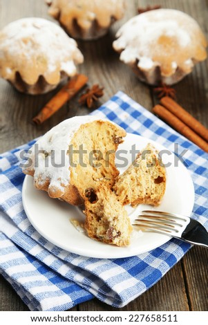 Cupcake on plate on brown wooden background