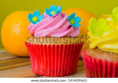 Cupcake on wood table - stock photo