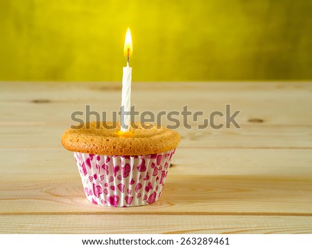 Cupcake on wooden table - stock photo