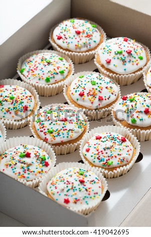 Cupcake packaging, delivery box, vanilla cupcakes with white glaze, selective focus, close up - stock photo