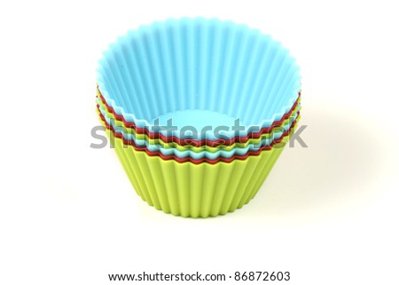 Cupcake silicon baking cups over white background