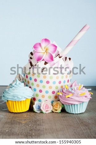 Cupcake sorbet on a blue background - stock photo