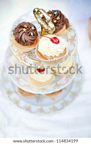 Cupcake stand outdoors - stock photo