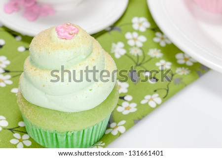 Cupcake . Vanilla cupcake with lime icing - stock photo