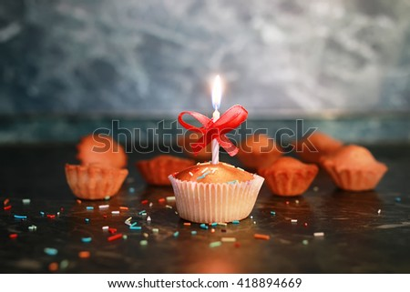 cupcake with a candle holiday - stock photo