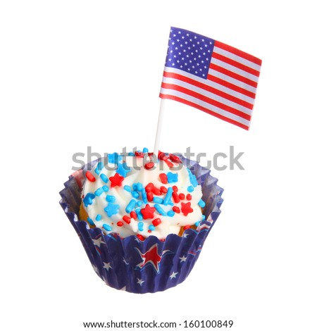 Cupcake with American Flag with red and blue sprinkles on the top, isolated on white background.  - stock photo