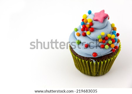 cupcake with blueberry frosting  colorful sprinkles Isolated on white.   - stock photo