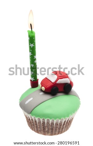 cupcake with car icing isolated on a white background - stock photo
