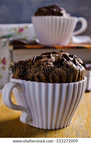 Cupcake with chocolate in a silicone mold. Selective focus. - stock photo