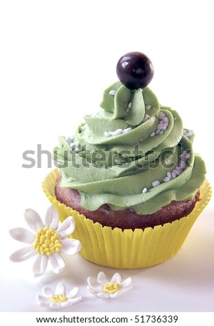Cupcake with Daisies - stock photo