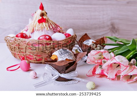 Cupcake with icing, Easter eggs, tulips - Easter composition - stock photo