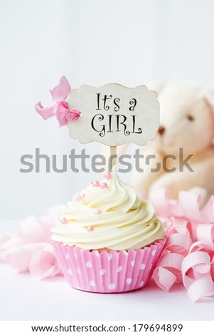 "Cupcake with ""it's a girl"" pick"
