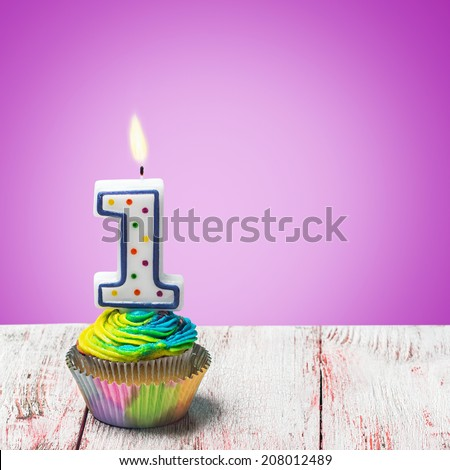 Cupcake with number one on a purple background. birthday greetings - stock photo
