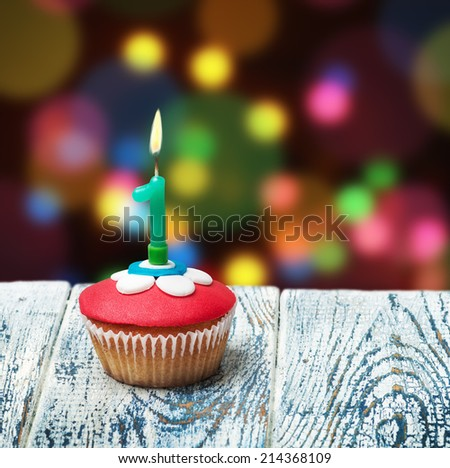 Cupcake with number one on background. birthday greetings - stock photo