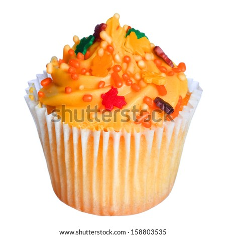 Cupcake with orange frosting and colored sprinkles isolated on white. Sweet food for Halloween - stock photo