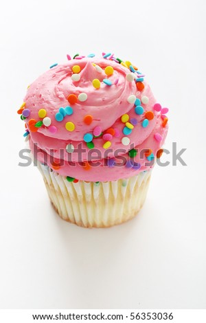 Cupcake with pink frosting and sprinkles vertical - stock photo