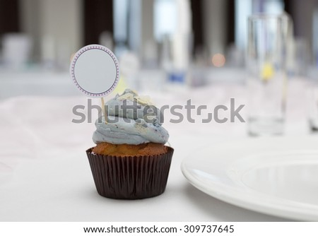 Cupcake with place card on wedding table  - stock photo